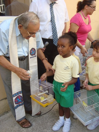 Fr D Mintoff with Sarah Ann and her pet